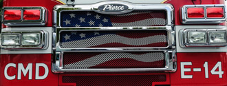 American flag in fire engine grill